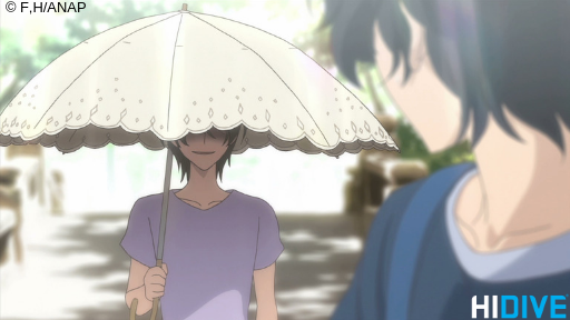 Momo's mom smiling underneath an umbrella