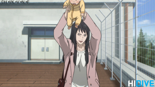 Ryoko holds her child above her head.